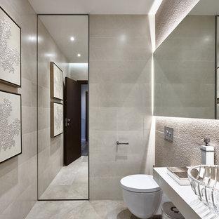Выдающиеся фото от архитекторов и дизайнеров интерьера: туалет в современном стиле с серым полом