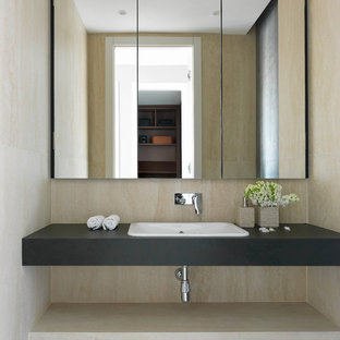 Inspiration for a medium sized contemporary cloakroom in Moscow with beige tiles, porcelain tiles, porcelain flooring, tiled worktops, grey floors, grey worktops and a built-in sink.