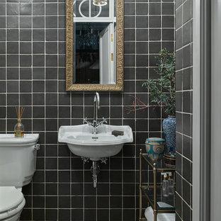 На фото: туалет в стиле современная классика с раздельным унитазом, черной плиткой, керамической плиткой, черными стенами, подвесной раковиной и разноцветным полом с