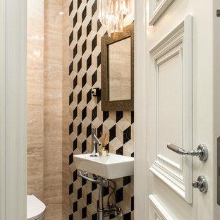 На фото: туалет в стиле современная классика с инсталляцией, бежевой плиткой и подвесной раковиной с
