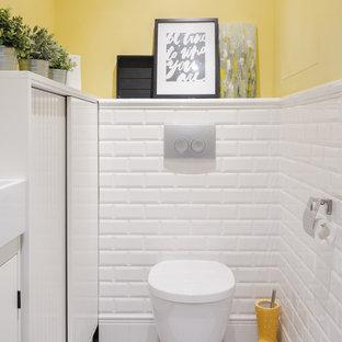 Idéer för vintage toaletter, med en vägghängd toalettstol, vit kakel, tunnelbanekakel och gula väggar