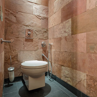 Design ideas for a small mediterranean cloakroom in Moscow with a wall mounted toilet and slate flooring.