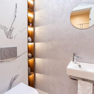 Неиссякаемый источник вдохновения для домашнего уюта: туалет в современном стиле с подвесной раковиной и белым полом