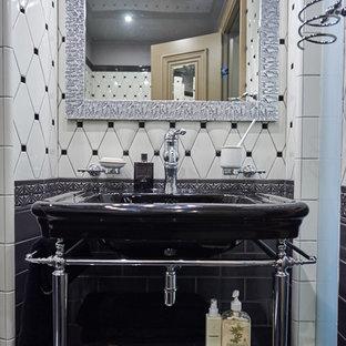 На фото: туалет в стиле современная классика с консольной раковиной, белой плиткой, черно-белой плиткой и черной плиткой
