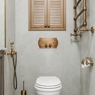 Пример оригинального дизайна: туалет в стиле современная классика с инсталляцией, серой плиткой и синим полом