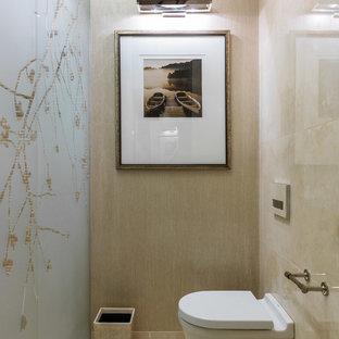 На фото: туалет в стиле современная классика с инсталляцией, бежевой плиткой и бежевым полом с