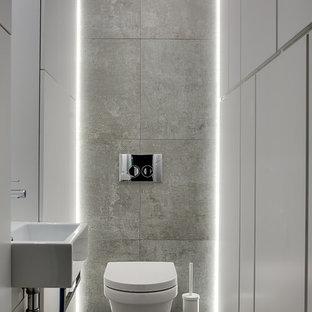 Неиссякаемый источник вдохновения для домашнего уюта: туалет в стиле лофт с инсталляцией, подвесной раковиной и серым полом