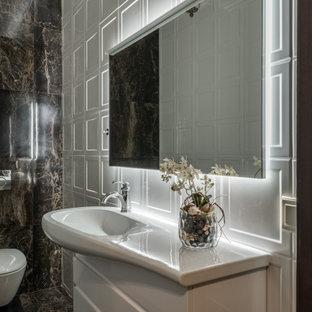 На фото: туалеты в современном стиле с плоскими фасадами, белыми фасадами, инсталляцией, белой плиткой, монолитной раковиной, коричневым полом и коричневой столешницей