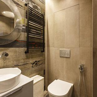 Выдающиеся фото от архитекторов и дизайнеров интерьера: туалет в стиле лофт с плоскими фасадами, раздельным унитазом, серыми стенами, настольной раковиной и серым полом