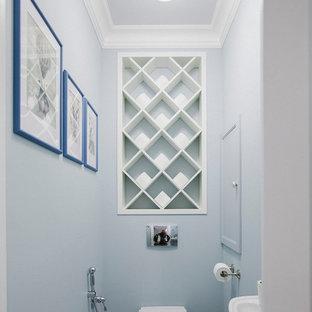 Пример оригинального дизайна интерьера: туалет в стиле современная классика с инсталляцией, подвесной раковиной, синими стенами, полом из цементной плитки и разноцветным полом