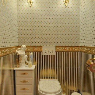 Design ideas for a traditional cloakroom in Yekaterinburg with a wall mounted toilet, white tiles and multi-coloured tiles.