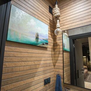 На фото: маленький туалет в стиле лофт с открытыми фасадами, белыми фасадами, инсталляцией, коричневой плиткой, керамогранитной плиткой, серыми стенами, полом из керамической плитки, подвесной раковиной, столешницей из искусственного кварца, серым полом и белой столешницей с