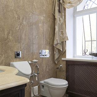 На фото: туалет среднего размера в классическом стиле с коричневой плиткой, керамогранитной плиткой, полом из мозаичной плитки, врезной раковиной, мраморной столешницей и писсуаром