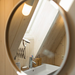 Design ideas for a medium sized contemporary cloakroom in Saint Petersburg with a one-piece toilet, white walls, slate flooring, a built-in sink, wooden worktops and black floors.
