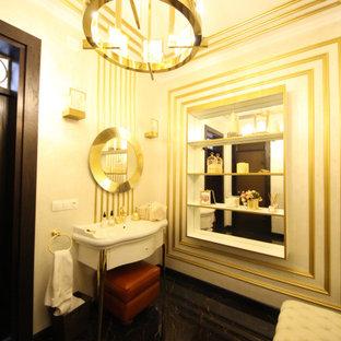 モスクワの中くらいのエクレクティックスタイルのおしゃれなトイレ・洗面所 (インセット扉のキャビネット、白いキャビネット、壁掛け式トイレ、ベージュのタイル、磁器タイル、ベージュの壁、セラミックタイルの床、ペデスタルシンク、人工大理石カウンター、黒い床、白い洗面カウンター、独立型洗面台、格子天井、パネル壁) の写真