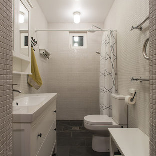 Medium sized contemporary cloakroom in Saint Petersburg with white cabinets, a one-piece toilet, white tiles, mosaic tiles, white walls, slate flooring, a built-in sink and black floors.