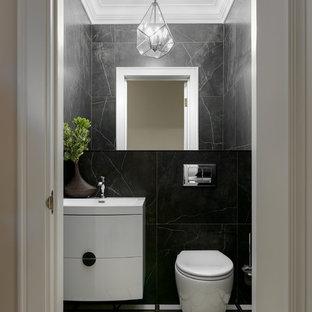 Стильный дизайн: туалет в современном стиле с плоскими фасадами, белыми фасадами, инсталляцией, черной плиткой, монолитной раковиной и разноцветным полом - последний тренд