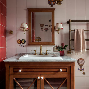 Inspiration for a traditional cloakroom in Moscow with medium wood cabinets, multi-coloured tiles, red tiles, white tiles, a built-in sink, grey floors, grey worktops and glass-front cabinets.