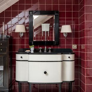 Exemple d'un WC et toilettes chic avec un carrelage rouge, des carreaux de céramique, un sol en carreaux de ciment, un plan de toilette en marbre, un sol blanc, un plan de toilette noir, un placard à porte plane et des portes de placard blanches.