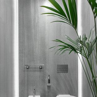 Идея дизайна: туалет среднего размера в стиле модернизм с инсталляцией, серой плиткой и керамогранитной плиткой