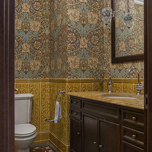 This is an example of a victorian cloakroom in Moscow with recessed-panel cabinets, dark wood cabinets, a two-piece toilet, multi-coloured walls, multi-coloured floors and yellow worktops.