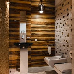 Пример оригинального дизайна интерьера: туалет в современном стиле с инсталляцией и подвесной раковиной