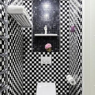 На фото: туалет в стиле фьюжн с инсталляцией, черно-белой плиткой, полом из мозаичной плитки и разноцветным полом