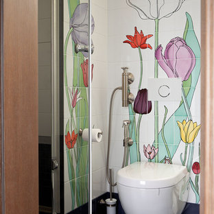 Design ideas for a cloakroom in Moscow with a wall mounted toilet, multi-coloured tiles, ceramic tiles, porcelain flooring and black floors.