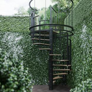 Ejemplo de jardín actual con jardín vertical y exposición total al sol