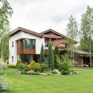 Пример оригинального дизайна: летний участок и сад в современном стиле с полуденной тенью