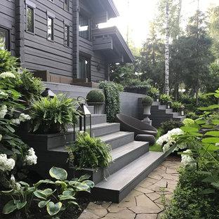 Пример оригинального дизайна интерьера: солнечный участок и сад на заднем дворе в стиле современная классика с освещенностью и мощением тротуарной плиткой
