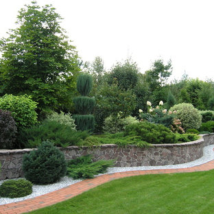 This Is An Example Of A Traditional Full Sun Brick Retaining Wall Landscape  In Moscow.