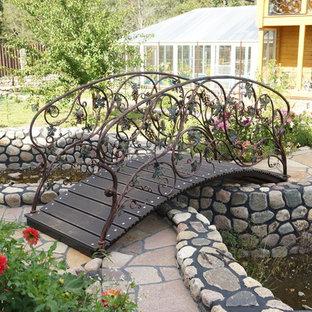 Новые идеи обустройства дома: участок и сад в классическом стиле с прудом