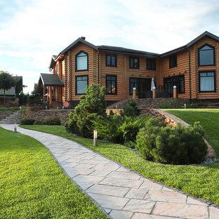 Стильный дизайн: летний участок и сад в современном стиле с подпорной стенкой и полуденной тенью - последний тренд
