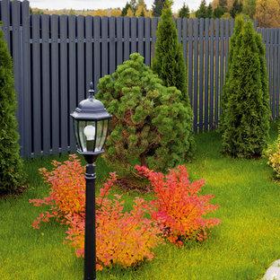 Inspiration pour un jardin traditionnel l'été avec un mur de soutènement et une exposition ensoleillée.