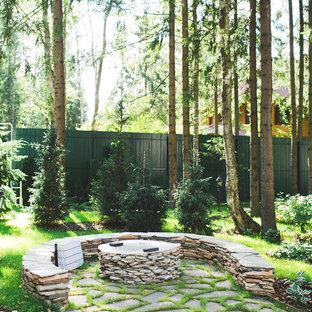 Новые идеи обустройства дома: летний сад в современном стиле с костровой чашей и полуденной тенью