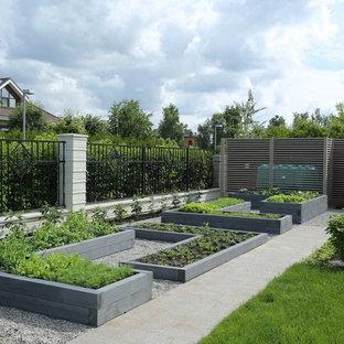 Esempio di un orto in giardino contemporaneo esposto in pieno sole di medie dimensioni in estate con ghiaia
