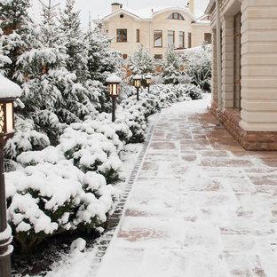 Foto di un giardino chic in inverno
