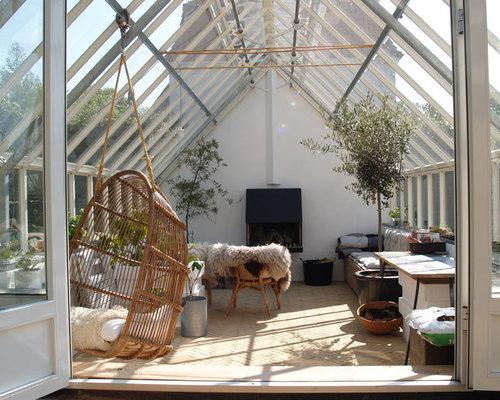 wintergarten mit verputztem kaminsims ideen design bilder houzz. Black Bedroom Furniture Sets. Home Design Ideas