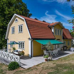 Photo of a large country side patio in Stockholm with an awning.