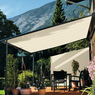 This is an example of a medium sized scandi back patio in Other with an awning and decking.
