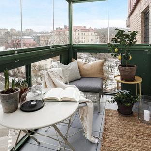 Idéer för att renovera ett mellanstort minimalistiskt uterum
