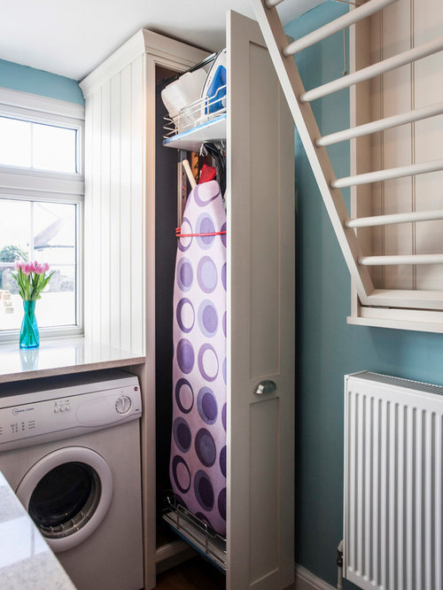 Example Of A Mid Sized Country L Shaped Medium Tone Wood Floor Laundry  Closet