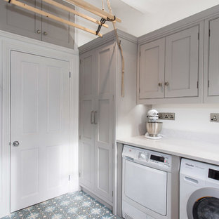 This is an example of a small traditional l-shaped separated utility room in Kent with beaded cabinets, grey cabinets, quartz worktops, white walls, ceramic flooring, a side by side washer and dryer and multi-coloured floors.