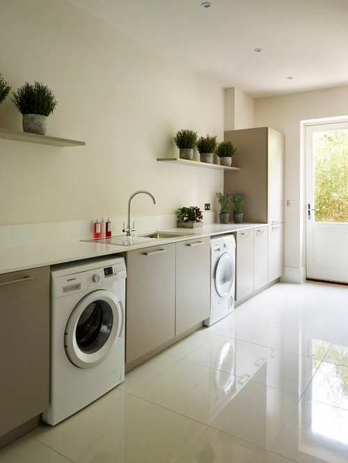 Laundry Room Design Ideas, Remodels & Photos with Beige Cabinets and Beige Walls