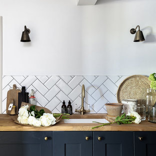Inspiration for a medium sized farmhouse galley utility room in Other with a single-bowl sink, shaker cabinets, blue cabinets, wood worktops, white walls and limestone flooring.