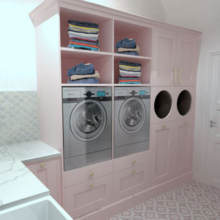 Small traditional l-shaped utility room in Buckinghamshire with a farmhouse sink, beaded inset cabinets, light wood cabinets, quartzite benchtops, pink splashback, ceramic splashback, white walls, ceramic floors, a stacked washer and dryer, pink floor, white benchtop and coffered.