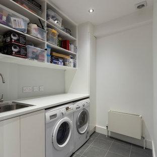 Laundry room - contemporary laundry room idea in Surrey