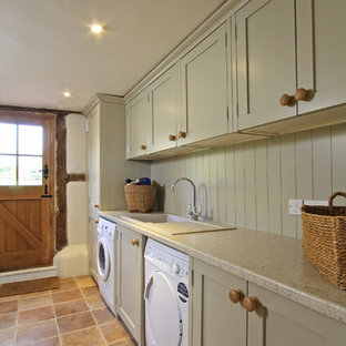 Design ideas for a country utility room in Hampshire with a built-in sink, shaker cabinets, a side by side washer and dryer and grey cabinets.