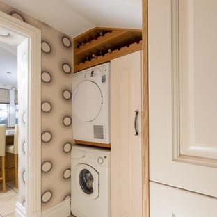 Classic utility room in Manchester with a stacked washer and dryer.